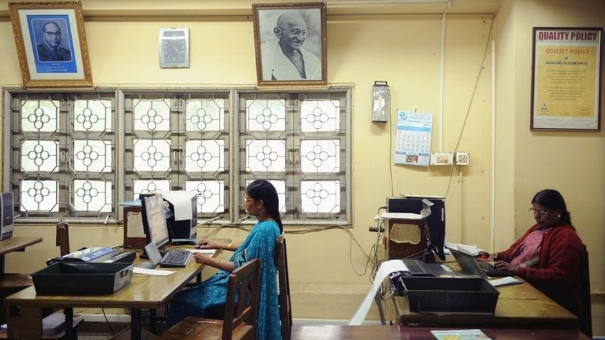 Employees feed in telegram messages onto computers to be sent via telegraph at a telecommunications office in Bangalore, on June 13, 2013. Thousands of Indians crammed into telegram offices on Sunday to send souvenir messages to friends and family in a last-minute rush before the service shuts down after 162 years.