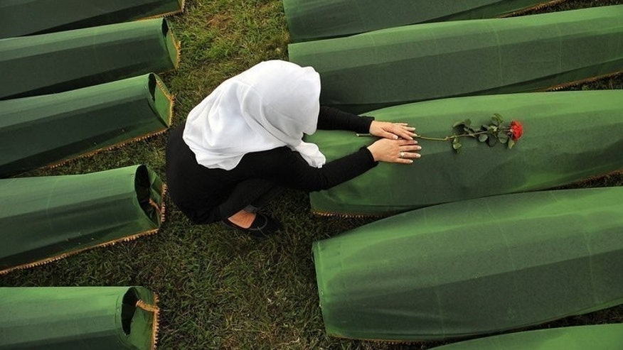 A Bosnian Muslim woman mourns for a relative killed in the Srebrenica massacre during a ceremony in Potocari, on July 10, 2013. A new church being built near Srebrenica is sowing fresh discord in a town which was the site of the worst massacre in post-war Europe.