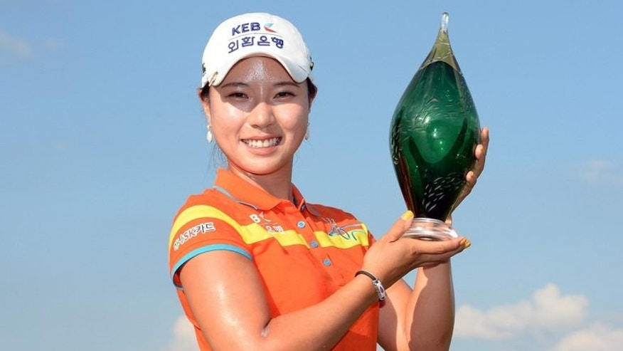 Park Hee-young of South Korea poses with the trophy after her win in a three hole playoff over Angela Stanford during the fourth round of the Manulife Financial LPGA Classic at the Grey Silo Golf Course on July 14, 2013 in Waterloo, Canada.