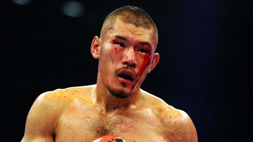 Japanese boxer Yuzo Kiyota bleeds during the WBO super-middleweight title fightagainst German super-middleweight champion Robert Stieglitz in Dresden, eastern Germany on July 13, 2013. A cut over Kiyota's left eye in the eighth round eventually saw the fight stopped after 15 seconds of the 10th and Stieglitz was awarded the fight unanimously 99-90, 100-89, 99-90 by the three judges.