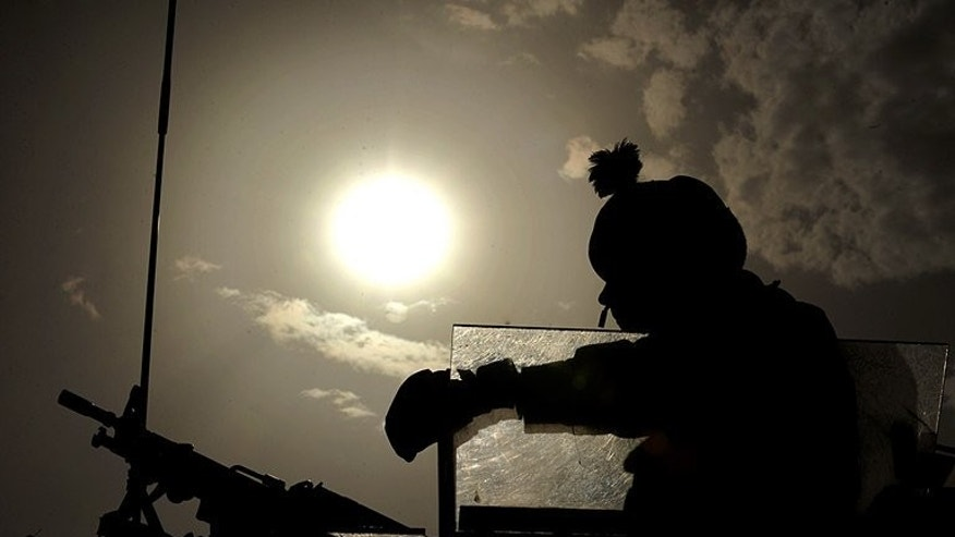 A British soldier keeps watch during a patrol on the outskirts of Kabul on July 27, 2008. A total of 50 serving and veteran British soldiers committed suicide last year, more than were killed fighting the Taliban in Afghanistan, according to figures reported on Sunday.