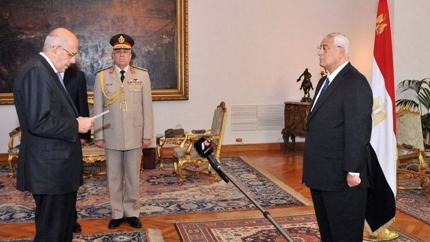 A picture released by the Egyptian Presidency shows Mohamed ElBaradei (L) being sworn in as Egypt's interim vice president for foreign relations, in front of Egypt's interim president Adly Mansour (R), in Cairo on July 14, 2013.