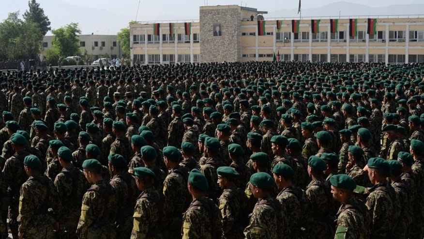 This file photo shows newly graduated Afghan National Army soldiers attending their graduation ceremony in Kabul, on May 23, 2013. An Afghan soldier held on suspicion of killing a NATO soldier from Slovakia has escaped from prison on a heavily guarded military base with the help of a guard, officials said on Monday.