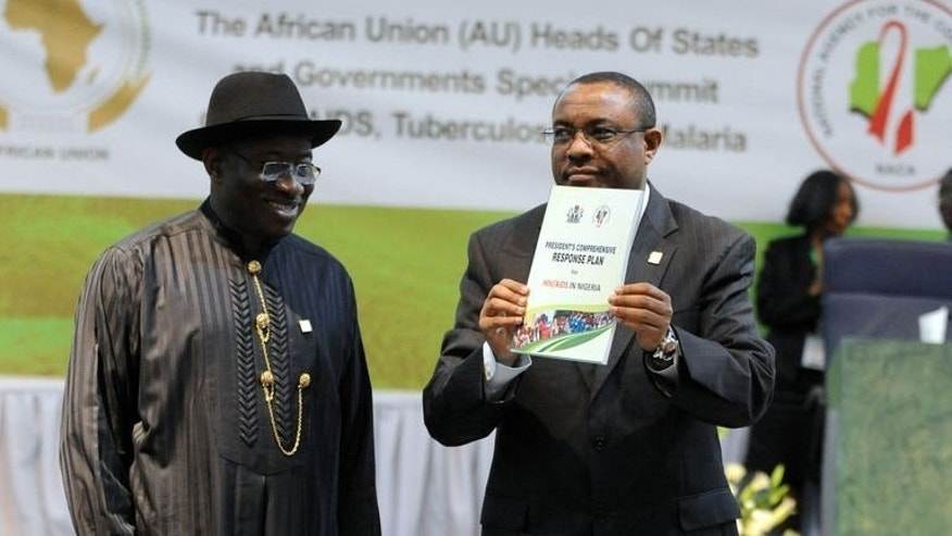 Nigeria's President Goodluck Jonathan looks on as Ethiopian PM Hailemariam Desalegn displays a publication at the opening session of the African Union Summit on health focusing on HIV/AIDS, TB and Malaria in Abuja on July 15, 2013. African leaders called for increased funding Monday to contain HIV/AIDS, TB and malaria as the continental health summit opened in Nigeria's capital.
