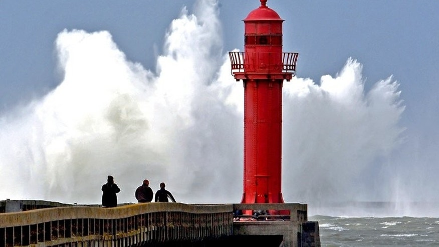 Waves rise up at the port of Boulogne-sur-Mer on March 11, 2008. A British woman died trying to swim across the Channel between Britain and France over the weekend, police and the Foreign Office said.