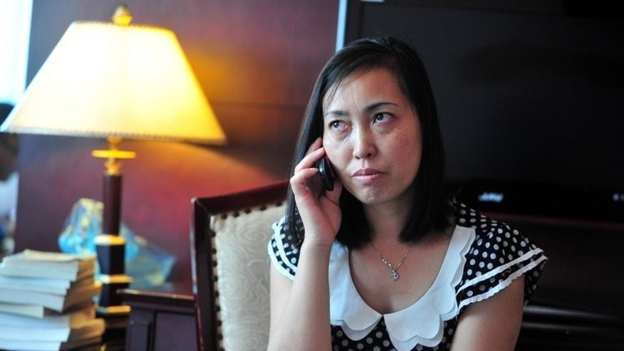 Tang Hui, mother of a young rape victim, pictured in Changsha, central China's Hunan province, on July 1, 2013. A court awarded damages to Tang after she was sent to a labour camp for demanding her daughter's attackers be punished, a spokesman said on Monday.