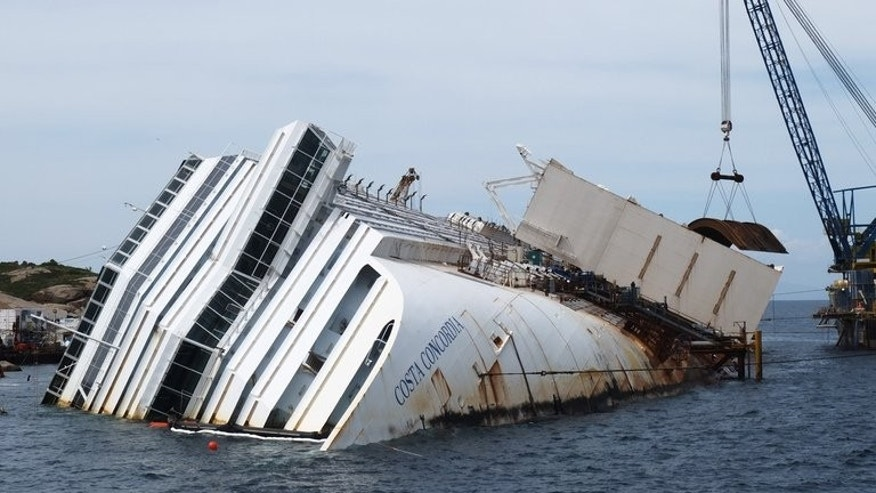 As the trial against the captain of Italy's Costa Concordia gets under way, the mayor of the island where the ship lies said he was increasingly concerned about its salvage.