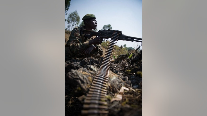 A DR Congo army soldier deployed at an attack position north-west of Munigi, overlooking the front-line, in the east of the Democratic Republic of the Congo on July 15, 2013.