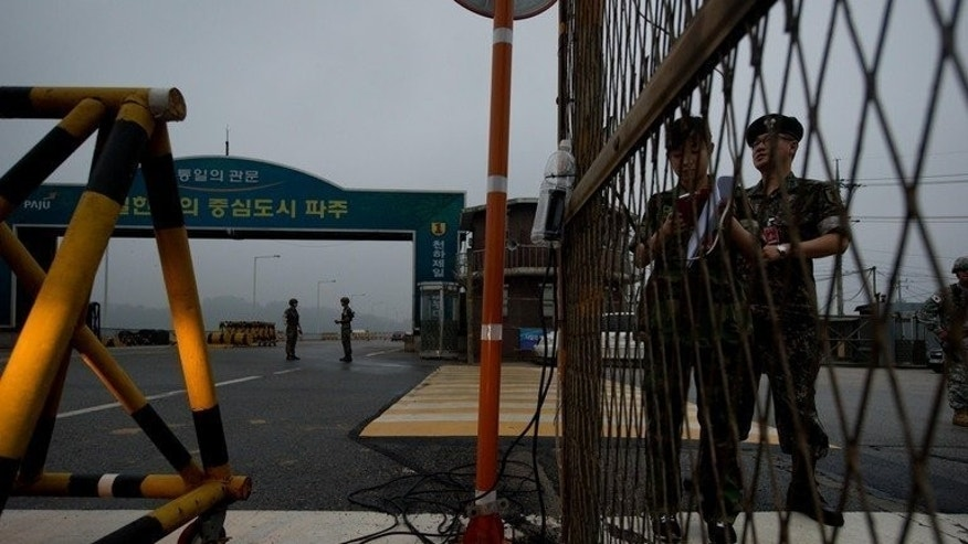 South Korean soldiers stand guard at a military checkpoint in Paju on July 10, 2013, The road leads towards North Korea's Kaesong joint industrial complex. North and South Korea have failed to reach agreement on reopening a jointly-run industrial estate, dimming hopes of an early improvement in ties after months of friction.
