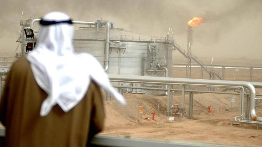 An employee of the Kuwait Oil Company (KOC) looks at the Gathering Center No.15 of al-Rawdatain field, north of Kuwait City on January 25, 2005. The Gulf state of Kuwait has discovered a new oil and gas field in Kabed area close to the well-known Manageesh oilfield, Hashem Sayed Hashem, CEO of state-owned Kuwait Oil Co said.