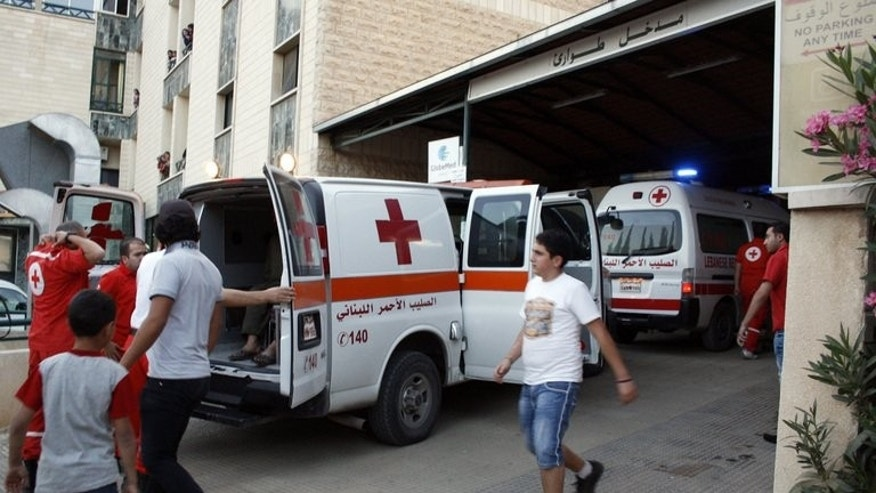 "An ambulance carries wounded Syrians from Qusayr at a hospital in Shtora on on June 7, 2013. A Lebanese hospital has ""forcibly"" ejected 30 Syrians patients wounded in violence in their country, an activist said, while the hospital said they were discharged over unpaid bills."