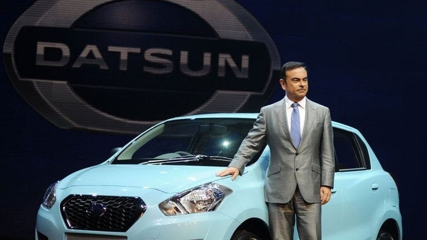 Nissan Motor Co chairman and chief executive Carlos Ghosn poses with the newly launched Datsun Go car in Gurgaon on the outskirts of New Delhi on July 15, 2013. Japanese carmaker Nissan resurrected its iconic budget Datsun marque on Monday to woo a new generation of cost-conscious buyers in emerging markets.