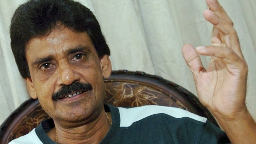 Former Pakistani hockey player Hanif Khan gestures as he speaks to media representatives in Karachi on September 24, 2006. Pakistan sacked their hockey coach Khan over the national team's poor finish in the World Hockey League, which raised fears they will not qualify for next year's World Cup.