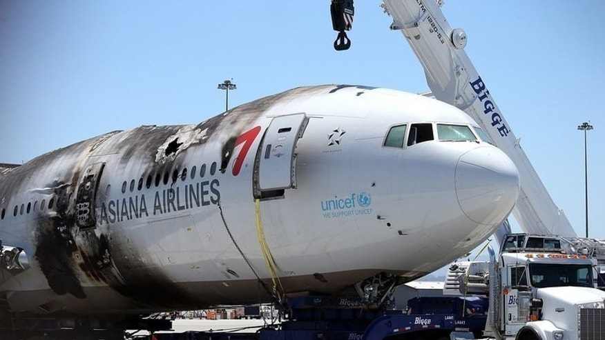 The wrecked fuselage of Asiana Airlines flight 214 sits in a storage area at San Francisco International Airport in San Francisco, California on July 12, 2013. South Korea's Asiana Airlines will be subject of a three-week government investigation after one of its passenger jets crash landed in San Francisco, officials said Monday.