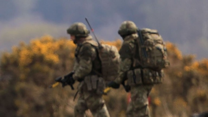 Soldiers are seen on exercise in Stranraer, Scotland on April 16, 2012. Two British soldiers died during a training exercise over the weekend as they took part in a gruelling selection process for the elite SAS unit on the hottest day of the year, military sources said.