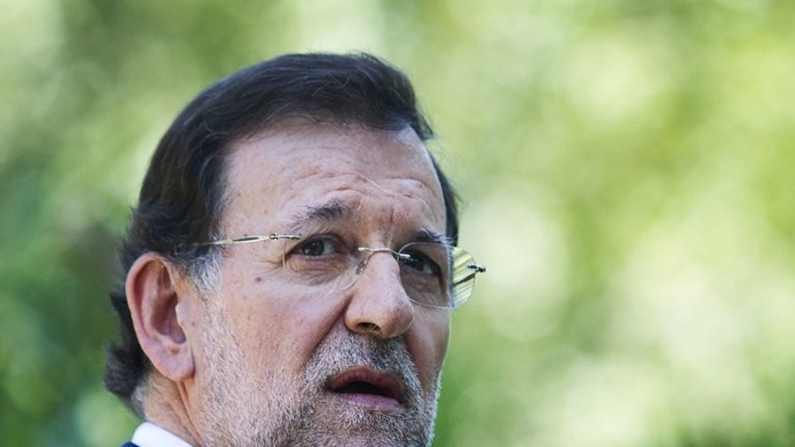 Spanish Prime Minister Mariano Rajoy gives a press conference in Mallorca, on August 14, 2012. Rajoy facing calls to explain himself or resign over his alleged support for the ruling Popular Party's disgraced former treasurer, who headed to court on July 15 over a slush fund scandal.