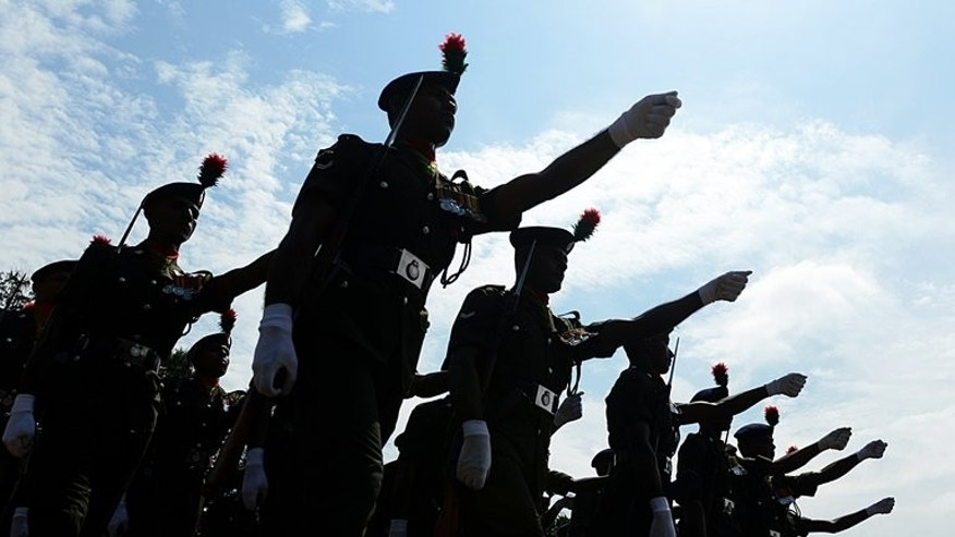 Sri Lankan soldiers march during a ceremony in Colombo on October 10, 2012. Sri Lanka has halted a French cultural festival after it screened an internationally-acclaimed local film that the military considered insulting, authorities said Monday.