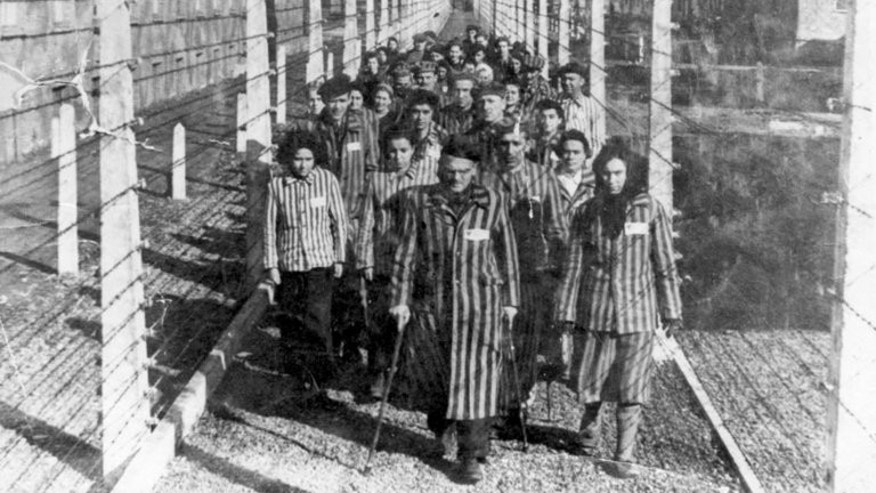 A photo of prisoners at the Auschwitz concentration camp in 1945. Holocaust survivors and victims' heirs have received $1.24 billion from a Swiss fund set up after a scandal over dormant accounts of Jews killed in World War II, according to the Swiss weekly Tachles.