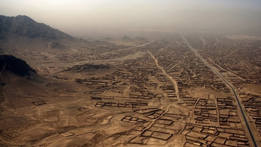 A view of the Arghandab Valley in Kandahar province is pictured from the air early on September 2, 2010. An Afghan accused of torturing and murdering civilians while working for US special forces denies the charges and says he followed American orders, according to a report obtained by AFP on Tuesday.