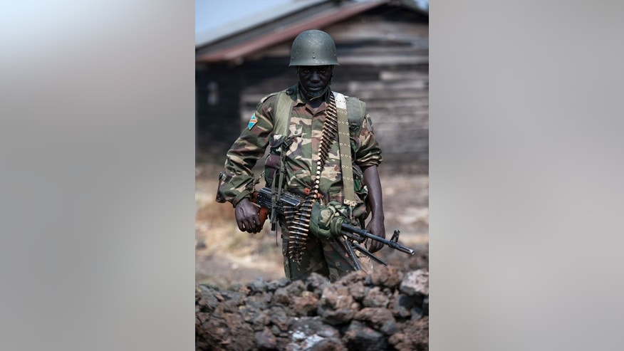 A Congolese army soldier at a forward position in Kanyarucinya, around 12 kms from Goma in the east of DR Congo, on July 16, 2013. The army on Tuesday pursued an offensive against rebels of the M23 movement to protect the North Kivu provincial capital of Goma, military sources said.