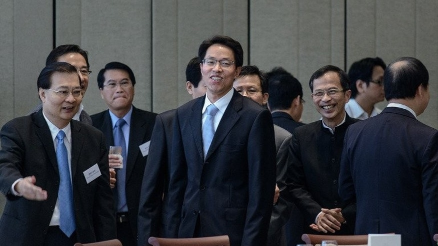 Zhang Xiaoming, head of the city's Beijing liaison, arrives for a luncheon with Hong Kong Legislative Council members and Beijing officials in Hong Kong on July 16, 2013. China's top representative in Hong Kong held unprecedented talks with local legislators Tuesday, two weeks after tens of thousands of protesters denounced the slow pace of political reform in the city.