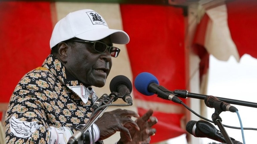 Robert Mugabe, president of Zimbabwe addresses an election campaign rally in Mashonaland Central province on July 11 2013. Mugabe forged ahead with a campaign to extend his 33-year rule Tuesday, lashing out at his perennial foe, ex-colonial power Britain, for political meddling.