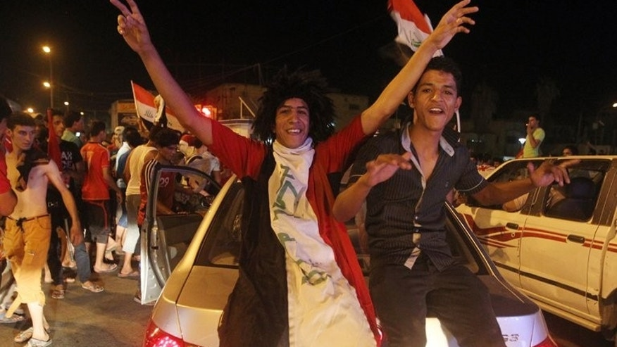 Iraqis celebrate in the streets of Baghdad after the Under-20 football team beat South Korea on July 7, 2013. Baghdad erupted with the sound of gunshots, fired individually or in automatic bursts.