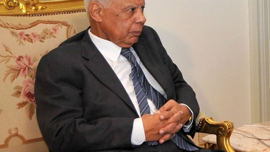 Caretaker prime minister Hazem al-Beblawi is pictured in Cairo on July 9, 2013, in an image provided by the Egyptian Presidency. Egypt's first government since the military ousted Islamist president Mohamed Morsi almost two weeks ago was officially sworn in on Tuesday, state television reported.