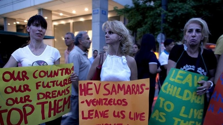 Greeks demonstrate against government economic austerity measures on July 15, 2013 in Athens.