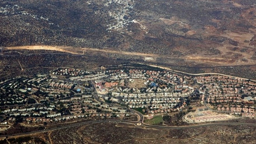 In this Sept. 20, 2010 aerial file photo, taken through the window of an airplane, the West Bank Jewish settlement of Ariel is seen.