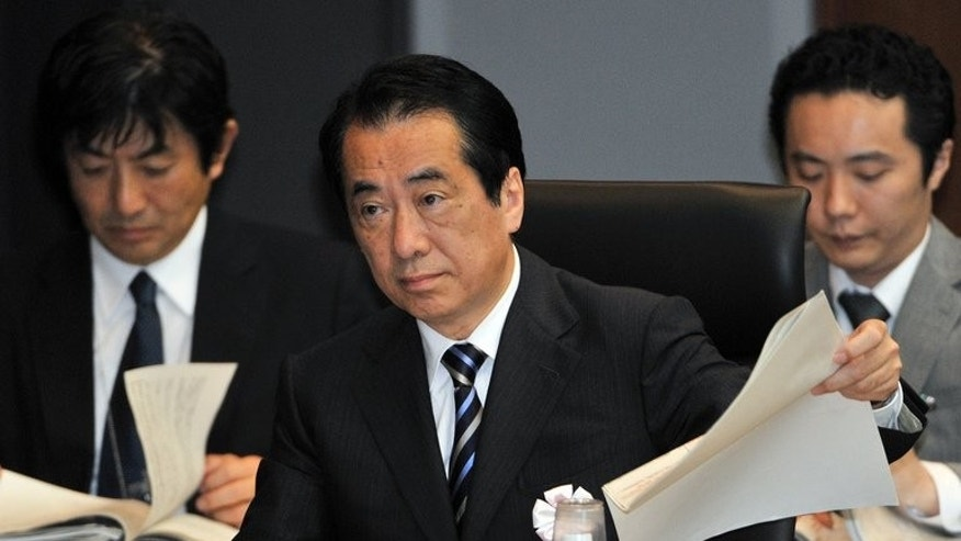 Former Japanese prime minister Naoto Kan speaks at a parliamentary commission in Tokyo on May 28, 2012 probing the Fukushima nuclear disaster. Japan's premier at the time of the Fukushima crisis said Tuesday he was suing the current prime minister for defamation over online comments about the way the emergency was handled.