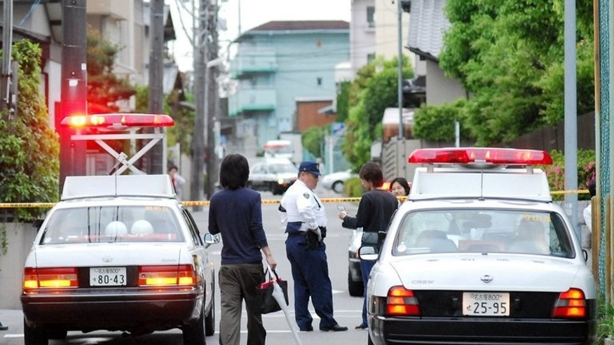 File photo of police in Japan. Tokyo police have arrested the alleged ringleader of a sex home-delivery service specialising in women weighing up to 150 kilograms (330 lbs).