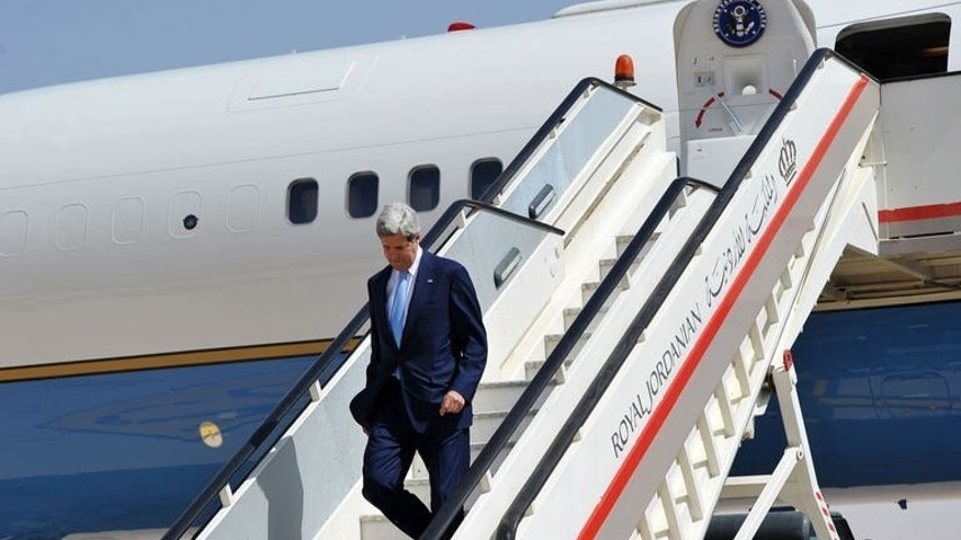 US Secretary of State John Kerry steps off his plane upon his arrival at Queen Alia International Airport in Amman, Jordan on July 16, 2013. Top US diplomat John Kerry met his Jordanian counterpart Tuesday for talks focused on the turmoil in Egypt and Syria as well as his bid to unlock the Middle East peace process.