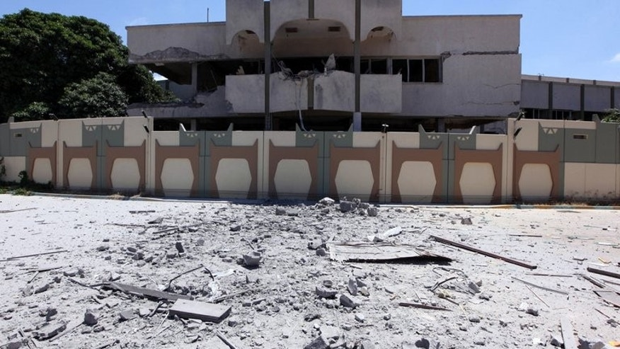 A damaged buildilng in Bab al-Aziziya in Tripoli on May 12, 2011. Slain Libyan dictator Moamer Kadhafi's sprawling residence in Tripoli, Bab al-Aziziya, will be turned into an amusement park under plans announced on Tuesday by the tourism minister.