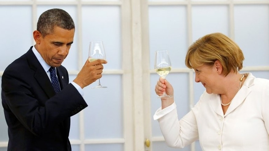 US President Barack Obama toasts with German Chancellor Angela Merkel during a state dinner in Berlin on June 19, 2013. Ten weeks before German elections, Chancellor Angela Merkel's centre-left rivals have gone on the attack over reports of sweeping US online surveillance and German cooperation, sparked by fugitive intelligence analyst Edward Snowden.