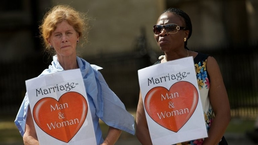 Campaigners against gay marriage protest outside the Houses of Parliament on July 15, 2013. MPs passed a bill legalising same-sex marriage in England and Wales, paving the way for the first gay weddings in 2014.