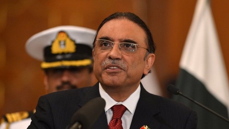 Pakistani President Asif Ali Zardari speaks during a joint press conference with unseen Chinese Premier Li Keqiang at the presidential palace in Islamabad on May 22, 2013. Pakistan's lawmakers will elect a new president on August 6, the election commission said Tuesday, to replace Asif Ali Zardari who will not stand for a second term.
