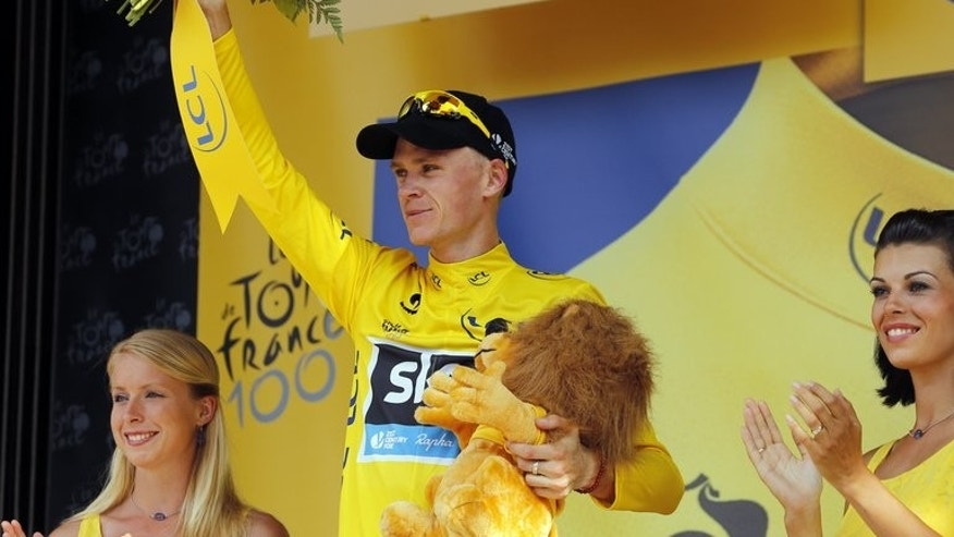 Chris Froome celebrates his overall leader's yellow jersey after the 16th stage of the Tour de France on July 16, 2013. On the 9.5 km climb to the Col de Manse, whose summit is 11.5 km from the finish, Froome came under attack from Alberto Contador and his Czech teammate Roman Kreuziger.