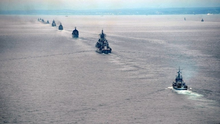 Russian military ships take part in exercises in the Pacific Ocean near the Sakhalin island on July 16, 2013. Despite the proximity to two of Russia's most important neighbours, Moscow insists that the exercises carry no hostile intent and are within international law.