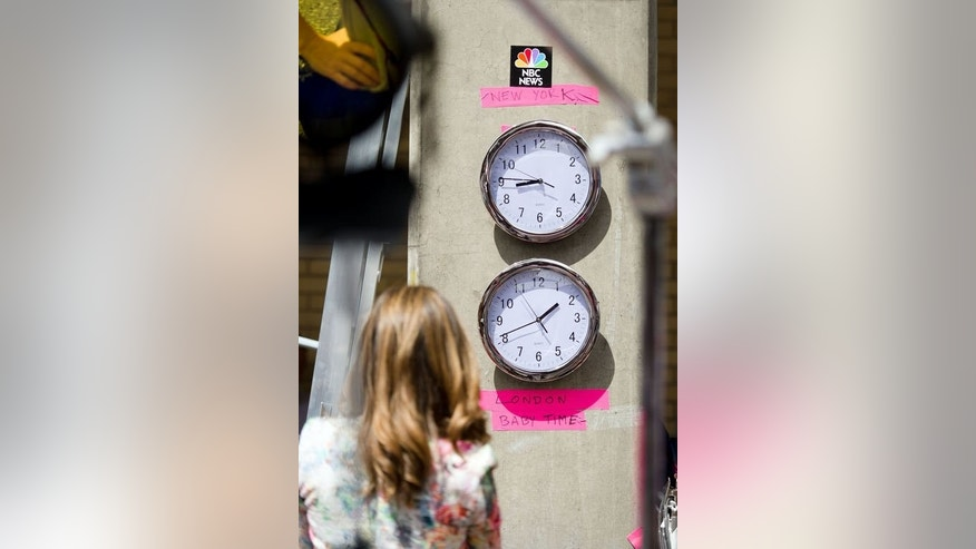 "Clocks showing New York and ""London Baby Time"" are hung on a wall in the media pen outside the Lindo Wing of Saint Mary's Hospital in London, on July 15, 2013."