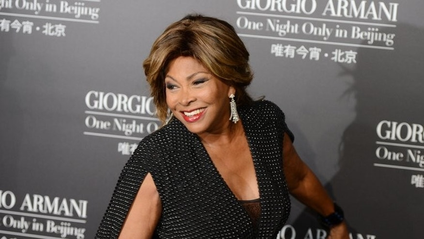 "Tina Turner arrives for a fashion show by Giorgio Armani in Beijing on May 31, 2012. Turner, the US-born superstar famed for hits such as ""Private Dancer"", has married her longtime German partner and will reportedly celebrate the union in a Buddhist ceremony in Switzerland Sunday."