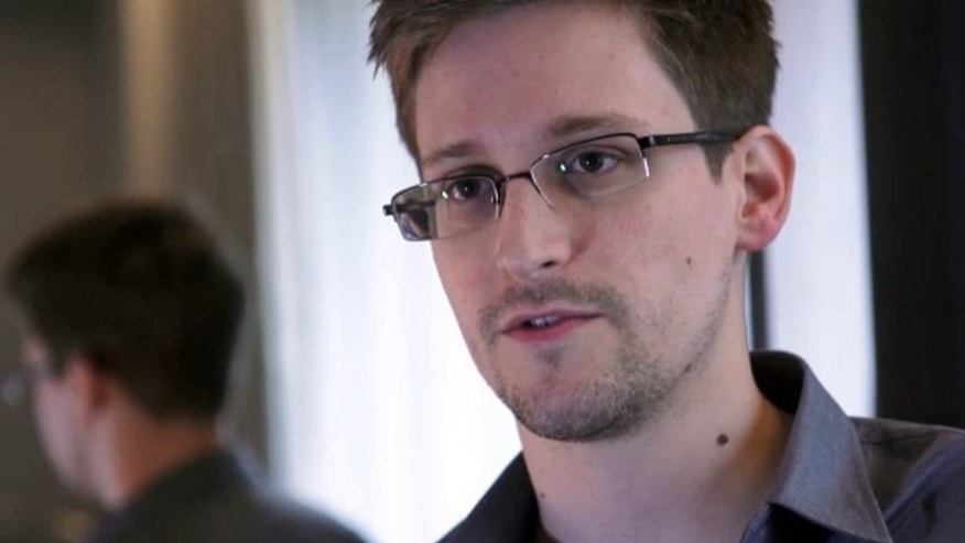 A video image recorded on June 6, 2013 of Edward Snowden in an interview with The Guardian. The US leaker, who has said he wants to apply for asylum in Russia, is studying his options and likely to make a decision shortly, a lawyer said.