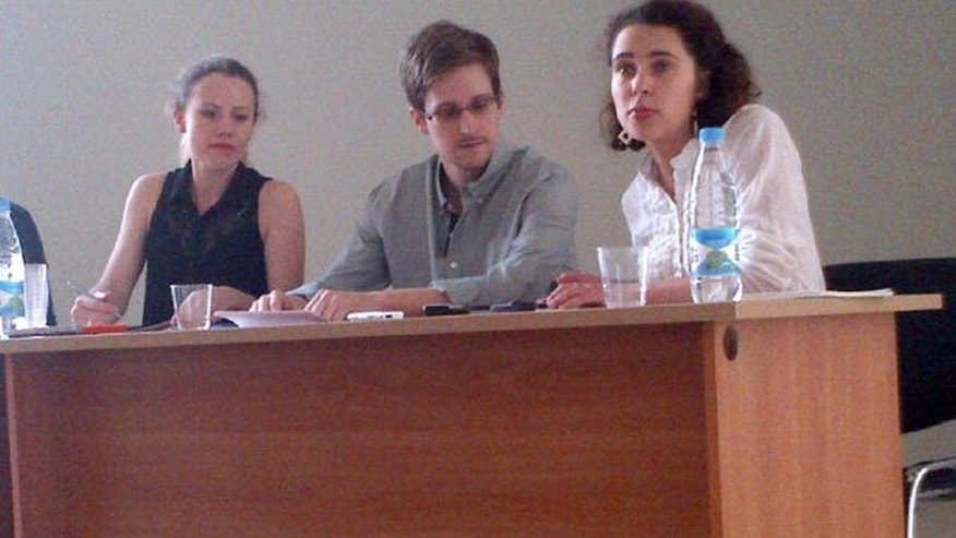 Picture released by Human Rights Watch shows Edward Snowden (C) in a meeting with rights activists at Moscow's Sheremetyevo airport, on July 12, 2013. The US leaker, who has said he wants to apply for asylum in Russia, is studying his options and likely to make a decision shortly, a lawyer said.