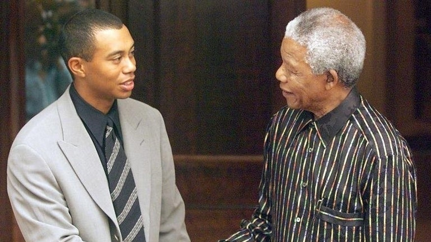 South African President Nelson Mandela (R) shakes hands with Tiger Woods, November 30, 1998 after receiving him at his Johannesburg residence. It takes a lot to impress a young golfing supremo who has just won the US Masters, but Woods on Tuesday recalled how his first meeting with Mandela 15 years ago was an experience like no other.