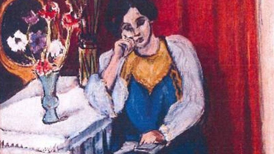 This is an unfated photo released by the police in Rotterdam, Netherlands, on Tuesday, Oct. 16, 2012, shows the 1919 painting 'Reading Girl in White and Yellow' by Henri Matisse.