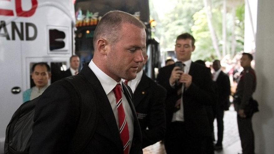 Manchester United's Wayne Rooney arrives at the hotel in Bangkok, on July 11, 2013. United have rejected a bid from English Premier League rivals Chelsea for Rooney, according to British media reports.
