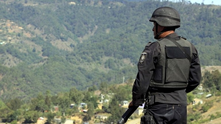 A Oaxaca State Police officer stands watch in Oaxaca, Mexico, on April 28, 2010. The bullet-riddled body of a Mexican crime beat reporter was found in the southern city of Oaxaca on Wednesday along with another unidentified victim, authorities said.