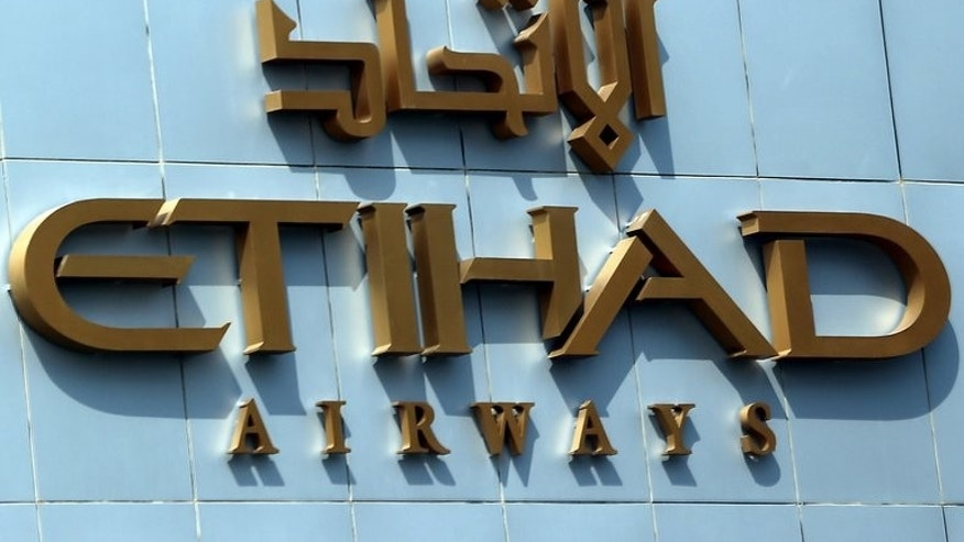 "The Etihad Airways headquarters in the Emirati capital Abu Dhabi on October 14, 2012. Etihad Airways chief James Hogan says the carrier is in Australia for the ""long-term game"" amid speculation that it was behind a flurry of Virgin share purchases this week."