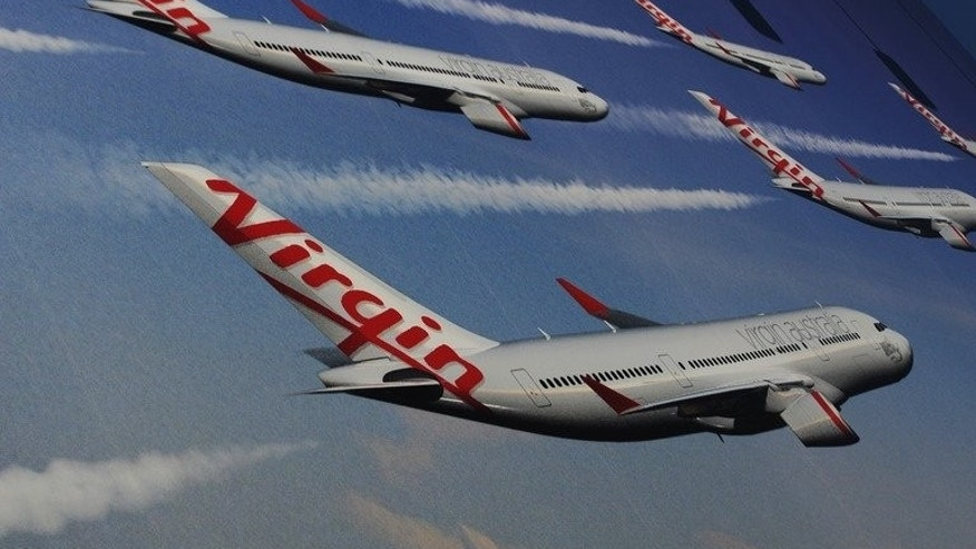 A Virgin Australia Airline billboard is displayed at the entrance to Sydney Airport, August 22, 2012. There has been speculation that Etihad Airways was on the prowl after a large parcel of Virgin shares sold Tuesday for almost Aus$7 million (US$6.5 million).