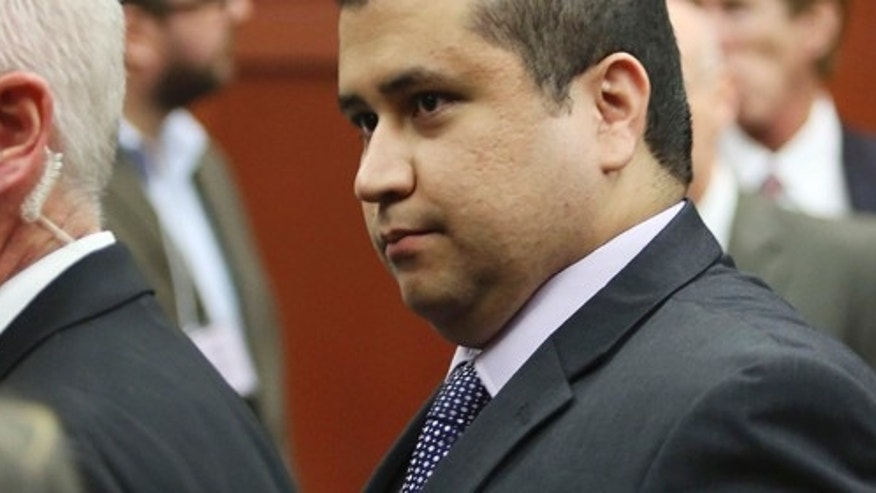 George Zimmerman leaves court with his family after Zimmerman's not guilty verdict was read in Seminole Circuit Court in Sanford, Fla. on Saturday, July 13, 2013. Jurors found Zimmerman not guilty of second-degree murder in the fatal shooting of 17-year-old Trayvon Martin in Sanford, Fla. (AP Photo/Gary W. Green, Pool)